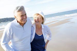 Senior man, woman on beach lifestyle image